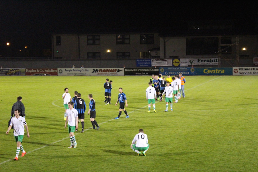 The two teams leaving the pitch after the final whistle.
